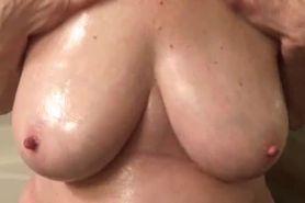 Oiling Up Big Tits