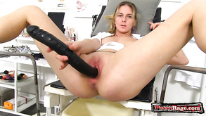 Amoral Young Nurse Plays With Gigantic Dildo